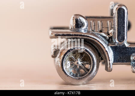 Metal chrome model vintage car closeup. - Stock Photo