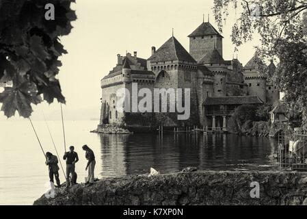 The historic 11th century Chillon Castle, on the banks of Lake Geneva, is Switzerlands most popular historic monument. - Stock Photo