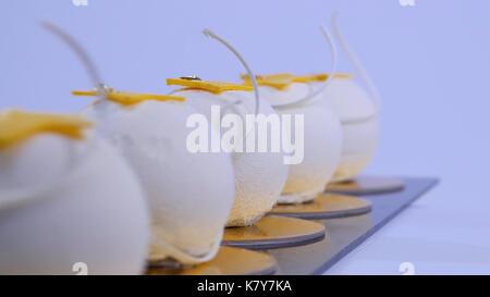 Velvet cake balls with sugar sprinkles. White, ball-shaped cakes. Decorative white cakes - Stock Photo
