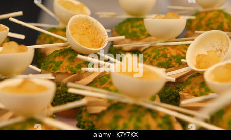 Carrot cake balls on kitchen table with marzipan. Many cakes are handmade from the creative pastry chef. Delicious - Stock Photo