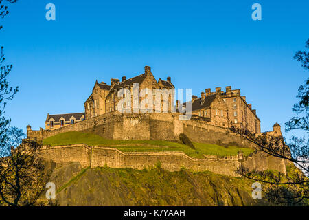 Edinburgh Castle is a historic fortress which dominates the skyline of the city of Edinburgh, Scotland, from its - Stock Photo