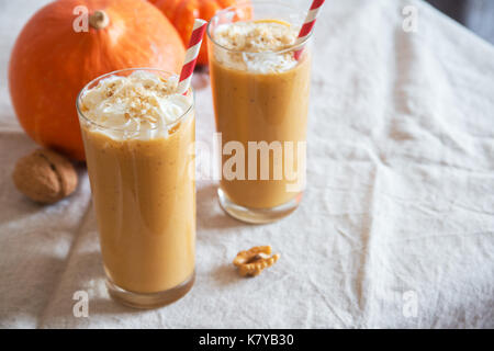 Pumpkin Smoothie. Fresh Pumpkin and Apple Smoothie or Milkshake with Walnuts and Autumn Spices. Seasonal Autumn - Stock Photo
