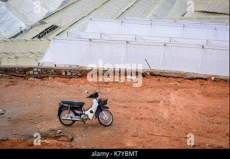 Tay Nguyen, Vietnam - Sep 20, 2015. Motorbike on the rural road in Central Highlands of Vietnam. Central Highlands - Stock Photo