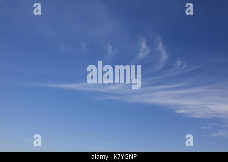 Cirrus Clouds Against a Blue Sky.  Photo by Willy Matheisl - Stock Photo