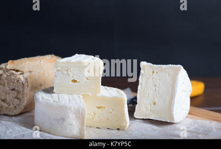 cheese on table with wine and bread - Stock Photo