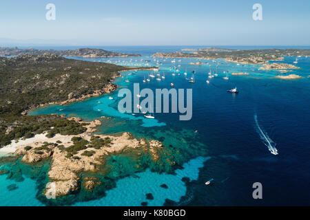 Aerial view of sailing yachts anchored near islands between Sardinia and Corsica - Stock Photo