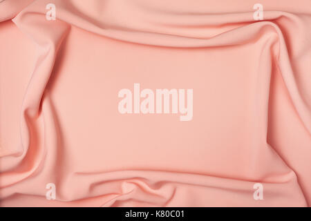 background of peach fabric draping close-up - Stock Photo
