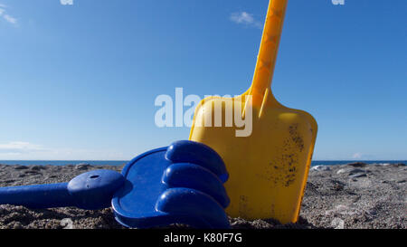 Close up view of children' plastic beach toys - Stock Photo