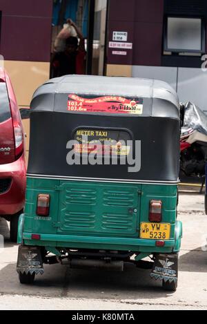 A metered tuk-tuk ( three-wheeler) taxi in Colombo, Sri Lanka.