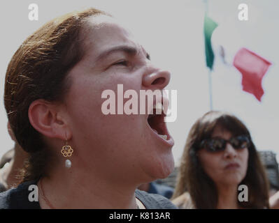 Hundreds of people march through Mexico City, Mexico, 17 September 2017, against the femicides after the commotion - Stock Photo