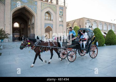 (170917) -- ISFAHAN (IRAN), Sept. 17, 2017 (Xinhua) -- Tourists ride a carriage to visit the Meidan Emam in Isfahan, - Stock Photo