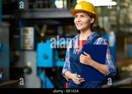 Pretty Technician with Clipboard - Stock Photo