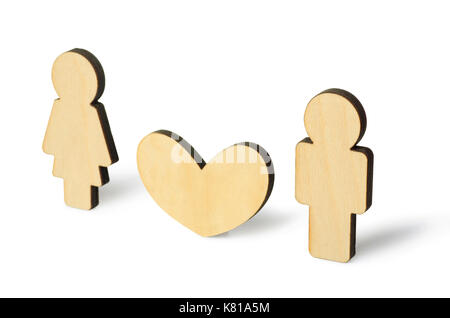 Wooden little man and woman with heart symbol of friendship, love and teamwork, isoalted on a white background - Stock Photo