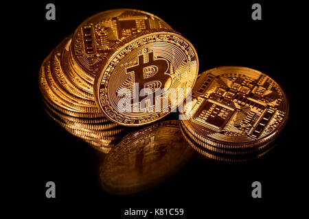 Golden bitcoins on black background. Bitcoin cryptocurrency - Stock Photo