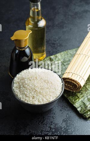 The sushi ingredient. Nori, rice, rice vinegar and soy sauce. - Stock Photo