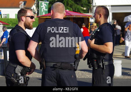 Rüsselsheim, Germany - June 12 2017: German Police officers on duty at Hessentag in Rüsselsheim, Germany - Stock Photo