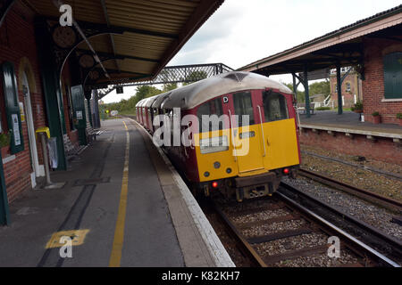 An island line main line railway train on the Isle of Wight uk using an old bakerloo line undergound train at brading - Stock Photo