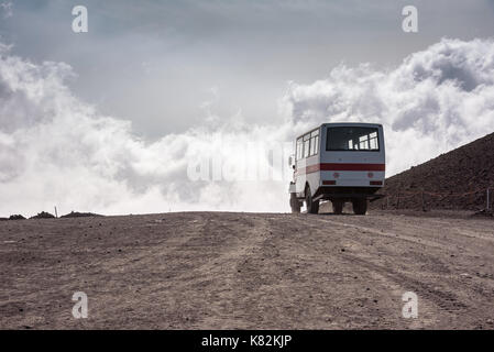 Departing bus from Torre del Filosofo on Mount Etna, Sicily, Italy - Stock Photo