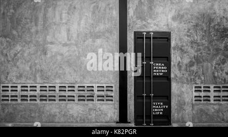 Closed iron door on concrete wall with ventilator, ,black and white scene - Stock Photo