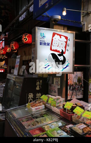the whale meat is for sale in Kuromon market in Osaka - Stock Photo