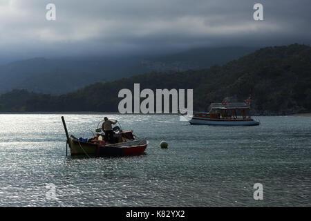 Boats sail on a rainy day, gloomy sky in Turkey. - Stock Photo