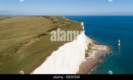 United Kingdom, East Sussex, Eastbourne, Beachy Head lighthouse, Seven Sisters coastline, white chalk cliffs of - Stock Photo