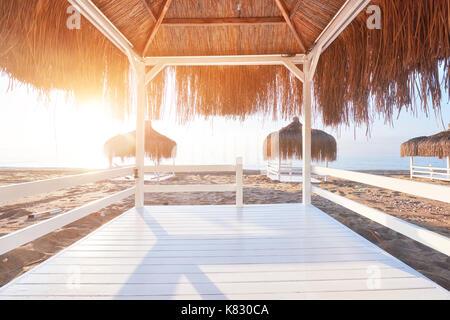 White chairs on the beach resort famous Amara Dolce Vita Luxury Hotel. Resort. Tekirova-Kemer. Turkey. - Stock Photo
