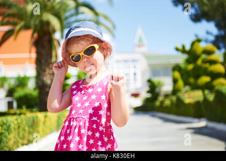 Portrait of a happy girl outdoors in summer day - Stock Photo
