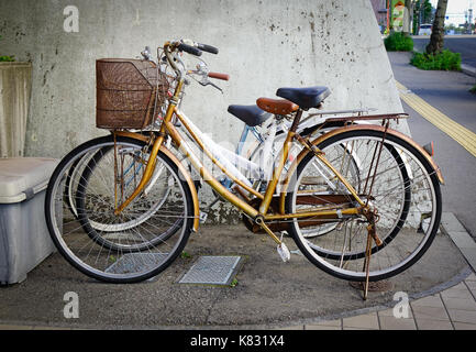 Akita, Japan - May 17, 2017. Bicycles parking outdoor at downtown in Akita, Japan. Akita is a large prefecture at - Stock Photo