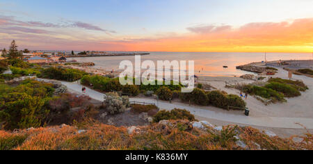 A summer sunset over a busy Bathers Beach in Fremantle, WA - Stock Photo
