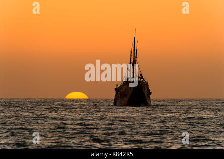 Ocean Sunset Ship Silhouette Is An Old Wooden Sitting At Sea Watching The On