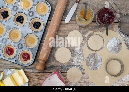 Making and baking homemade jam tarts. Pattern from above - Stock Photo
