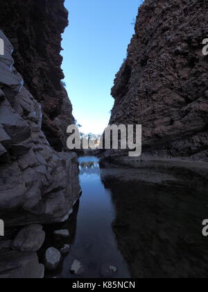Dark waters of Simpsons Gap in the the McDonnell Ranges near Alice Springs, Australia 2017 - Stock Photo