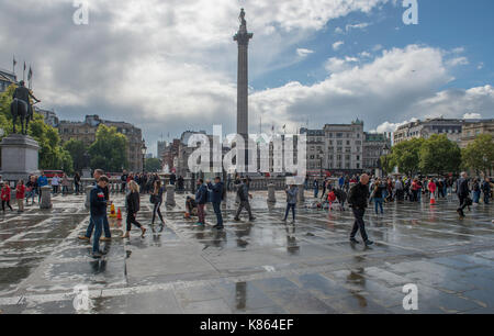 Trafalgar Square, London, UK. 18 September 2017. Clouds open to sunshine after a passing heavy shower. Credit: Malcolm - Stock Photo