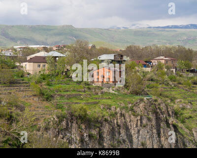 Houses in the village of Garni, Kotajk province, Armenia famous for its ancient temple, on the edge of a plateau - Stock Photo
