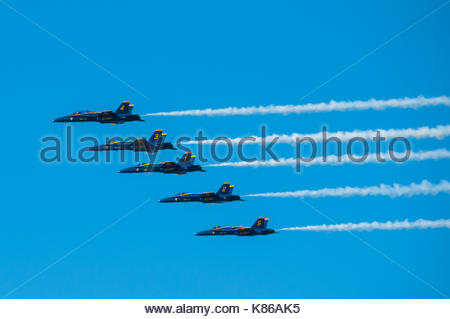 Blue Angels display over San Francisco as part of Fleet Week. McDonnell Douglas F/A-18 Hornets - Stock Photo