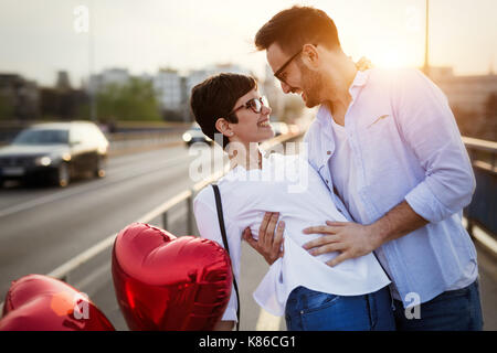 Young couple in love dating and smiling outdoor - Stock Photo