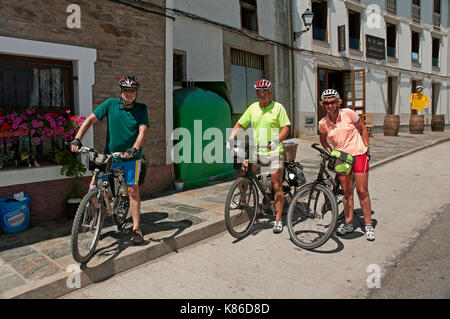 Cycling pilgrims, Samos, Lugo province, Region of Galicia, Spain, Europe - Stock Photo