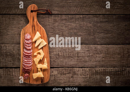 Cutting board with Salami and cheese, Italian Appetizers - Stock Photo