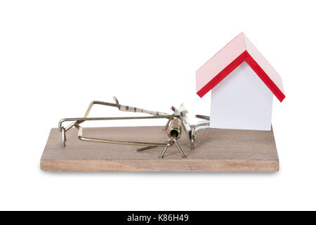 Closeup of house model on mousetrap against white background - Stock Photo