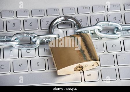 Closeup photo of padlock on laptop. Security concept - Stock Photo
