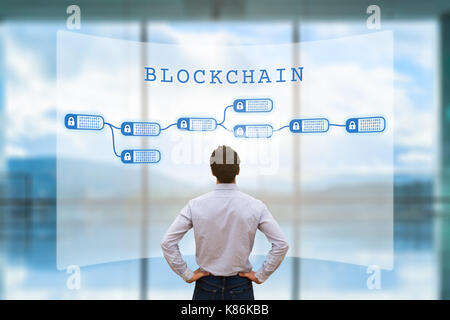 Person looking at blockchain concept on screen as a secured decentralized ledger for cryptocurrency financial technology - Stock Photo