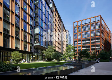 View of the park in the square looking towards 4 St Pancras Square. King's Cross Estate, London, United Kingdom. - Stock Photo