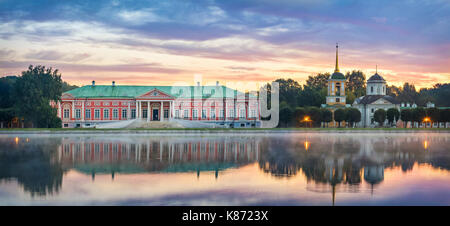 Panorama of Kuskovo estate with reflection in water on sunrise in Moscow, Russia - Stock Photo