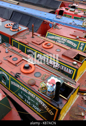 narrow boats in Gas Street Basin, on the historic canal network in Birmingham, England - Stock Photo