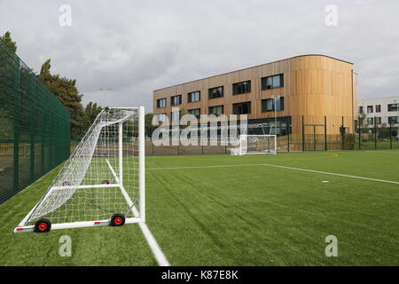 An artificial grass all-weather football pitch at a new secondary school in Slough, UK - Stock Photo