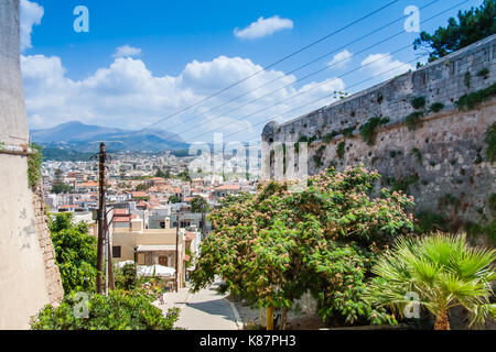 Panoramic view of Rethymno from the Venetian Fortress (Fortezza) with rooftops and mountains in the background. - Stock Photo