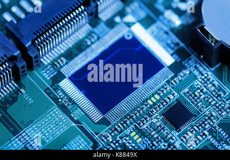 technology background circuit board toned in blue - Stock Photo