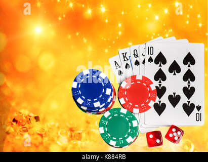 Combination of playing cards flush poker casino on golden sparking background - Stock Photo