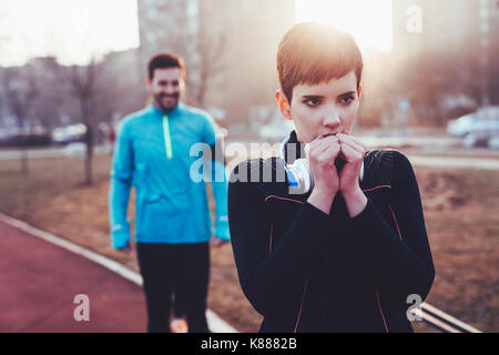 Woman fitness exercising in cold weather outdoor - Stock Photo